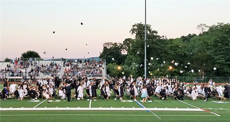 Cap toss at graduation